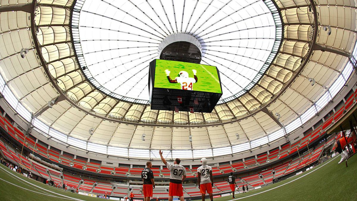BC Lions Jon Hameister-Ries #67 points out details of the inside of the newly redesigned BC Place stadium to teammates Dan McCullough #55 and Jamall Lee #23 in Vancouver, Sept. 29, 2011.