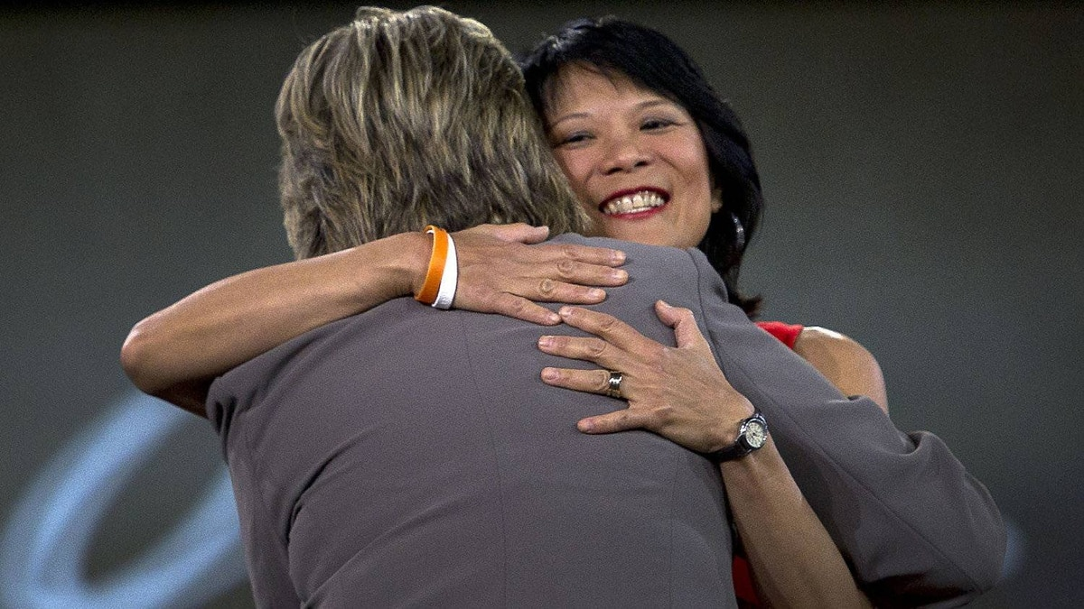 MP Olivia Chow receives a hug from Anne McGrath during a tribute to Jack Layton at the NDP leadership convention at the Metro Toronto Convention Centre in Toronto, Ont. Friday, March 23, 2012.