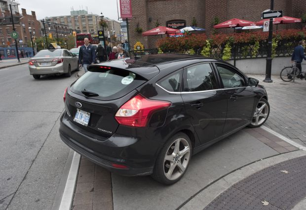 A Ride Sharing Car With An Uber Sticker On The Rear Window Turns South Onto Market St In Downtown Toronto Oct 3 2018