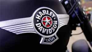 In this Jan. 20, 2012 photo, the Harley-Davidson logo is displayed on a new motorcycle for sale in the show room of Hall's Harley-Davidson Cycles, in Springfield, Ill.