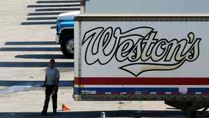 Weston Bakery truck trailers sit idle at a George Weston Ltd. owned facility on the Queensway in Toronto.