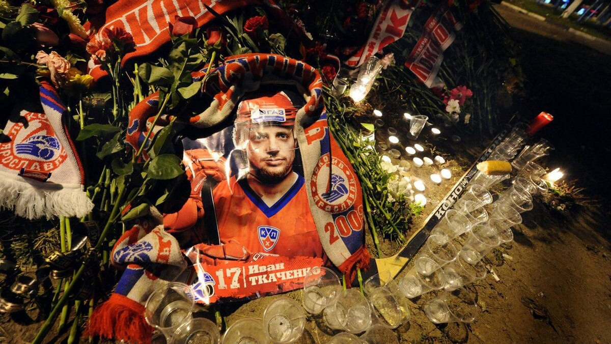 A portrait of Ivan Tkachenko, one of the players from the Lokomotiv Yaroslav ice hockey team thought to have perished in an air crash earlier in the day, is seen flanked by candles and glasses in front of Arena-2000, the team's home venue in Yaroslavl early on September 8, 2011. At least 44 people were killed on September 7 when a Russian jet carrying hockey players of Lokomotiv Yaroslavl to their first match of the KHL (Kontinental Hockey League) season crashed on takeoff in the latest blow to the country's tainted air safety record. Czech players Josef Vasicek, Jan Marek and Karel Rachunek were on Yaroslavl's roster this season along with Stefan Liv of Sweden and Slovak Pavol Demitra. Canadian manager Brad McCrimmon was coaching Lokomotiv this season.