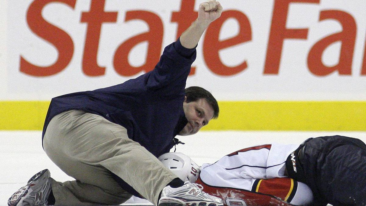 "In this Oct. 24, 2009, file photo, a person signals to the bench after checking on Florida Panthers forward David Booth, who was injured in the second period of an NHL hockey game against the Philadelphia Flyers in Philadelphia. The NHL's new rule banning blindside hits to the head is called ""Rule 48. It easily could be named after victims David Booth and Marc Savard, or offenders Mike Richards and Matt Cooke, who might be the last players to get away with such shots unscathed. For the first time, a lateral or blindside hit on an opponent in which the head is targeted or is the main area of impact will not only be subject to supplemental discipline, but a major penalty and ejection from the game. (AP Photo/Matt Slocum, File)"