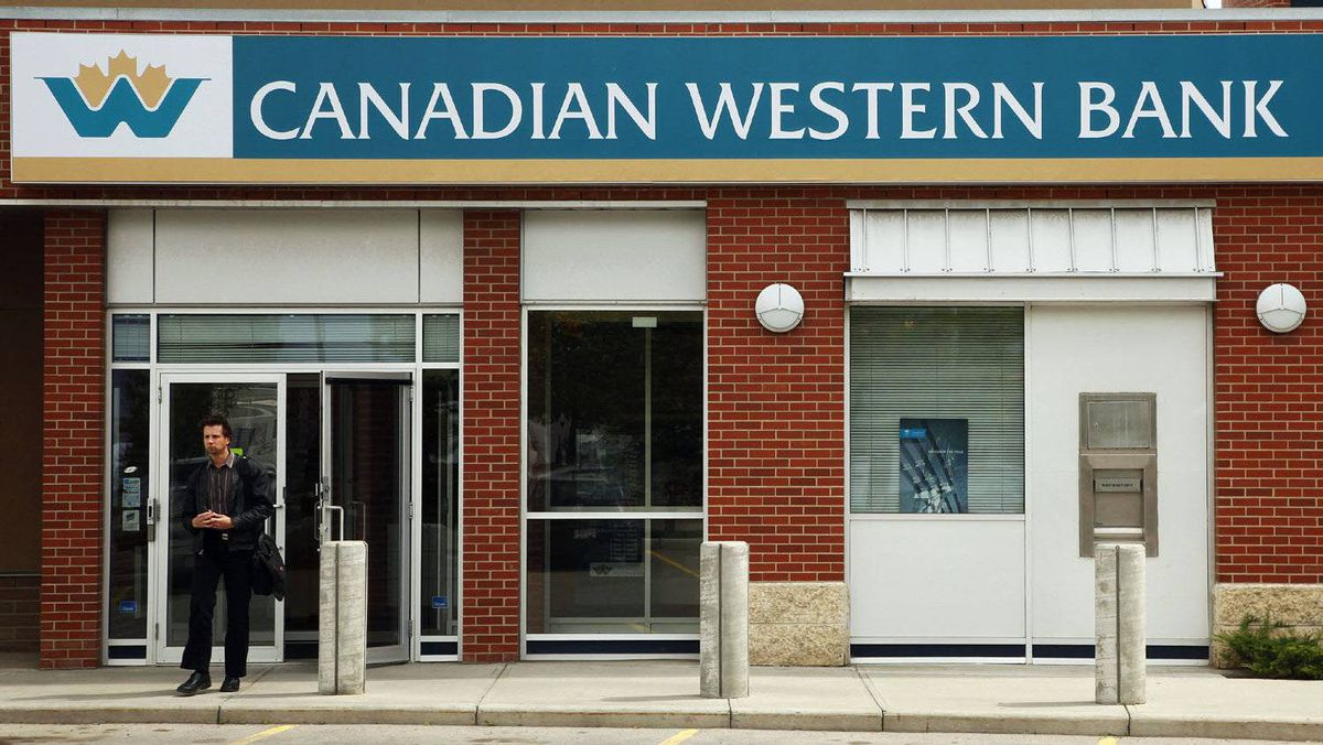 A customer walks out of a Canadian Western Bank branch in Calgary, Alberta June 9, 2009.