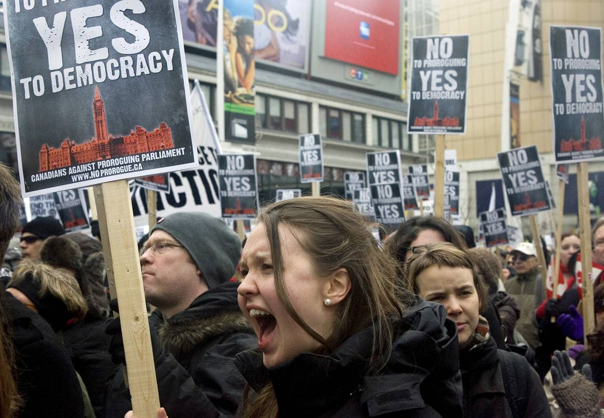Protesters march against Stephen Harper's prorogation of Parliament in Toronto on Saturday, Jan. 23, 2010.