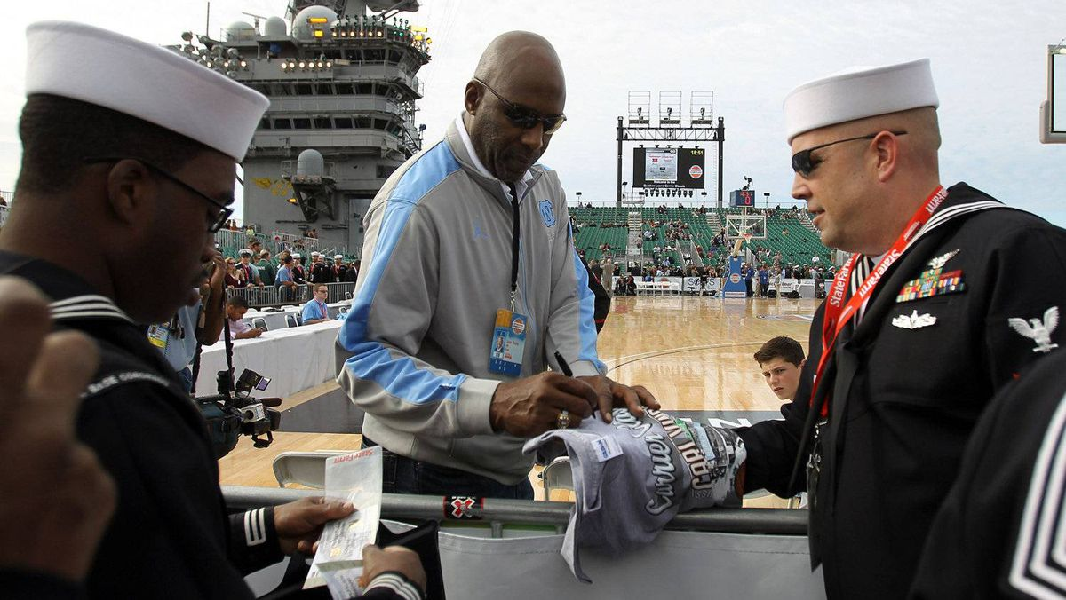 sketball hall-of-famer and North Carolina Tar Heels alum James Worthy signs autographs and talks with members of the media before the Tar Heels take on the Michigan State Spartans in the NCAA men's college basketball Carrier Classic aboard the flight deck of the USS Carl Vinson on November 11, 2011 in San Diego, California. (Photo by Ezra Shaw/Getty Images)