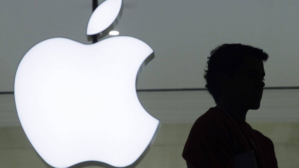 In this Dec. 7, 2011 photo, a person stands near the Apple logo at the company's new store in Grand Central Terminal in New York.