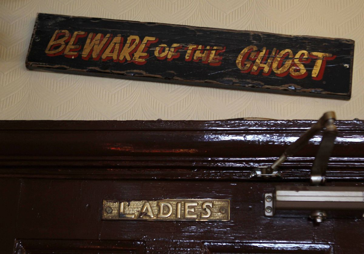 A sign is seen at the Bow Bells pub in east London. This pub is said to be haunted by a ghost that has a habit of flushing the ladies' toilet when patrons are sitting on it.