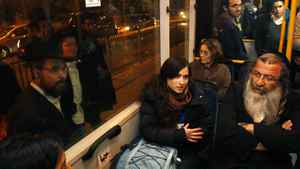 Israelis women (seated C) ride on a bus used mainly by the ultra-Orthodox Jewish community, during a protest against Jewish zealots trying to enforce gender separation in public places, in Jerusalem January 1, 2012. Ultra-Orthodox men trying to force women to sit in the back of public buses in deference to religious beliefs against any mixing of the sexes in public.