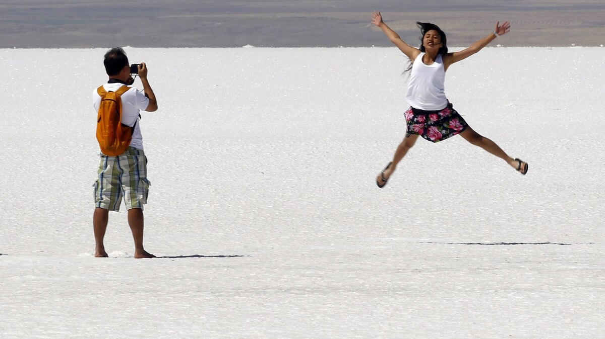 A tourist poses for pictures at Tuz Golu, about 130 km from Ankara August 29, 2011. Tuz Golu, which means Salt Lake in Turkish, is the second biggest lake in Turkey.