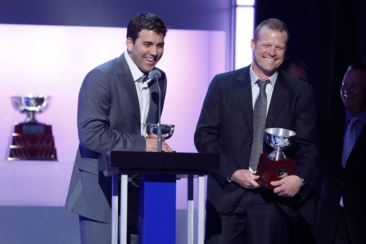 Tim Thomas and Manny Fernandez of the Boston Bruins accept the William M. Jennings Trophy during the 2009 NHL Awards at the Palms Casino Resort on June 18, 2009 in Las Vegas, Nevada.