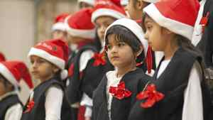 "December 15, 2011 - Surrey, BC -Harman Nijjar, grade 1, watches the christmas concert at Newton Elementary Thursday afternoon. The Parents' Council at Newton, which is made up of mostly Indo-Canadian students, decided that they will have a Christmas concert this year and call it a Christmas concert ""without any bhangra dancing."""