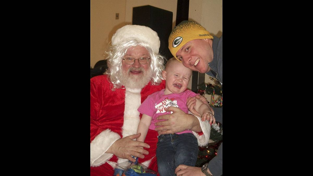 Jen Hayward photo: Maren meets Santa - We assume she's crying because of Santa.. .but maybe its because her dad is wearing a Packers hat and they had a pathetic year.