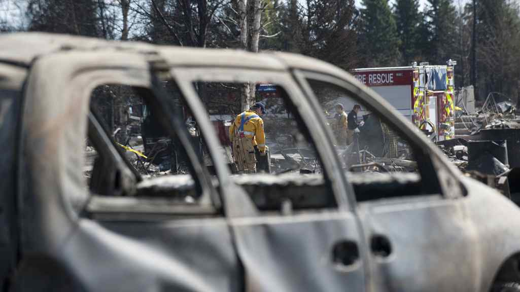 Crews are working in Slave Lake, Alberta, shutting of gas and water in burned out neighbourhoods on Wednesday May 18, 2011. A wildfire swept through the town of 7,000 destroying upwards of 40% of the buildings.