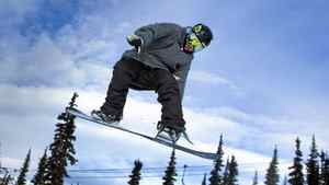 Snowboarder Dakotah Newman, 16, flies off a jump at Whistler February 10, 2011.