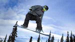 Snowboarder Dakotah Newman, 16, flies off a jump at Whistler February 10, 2011.
