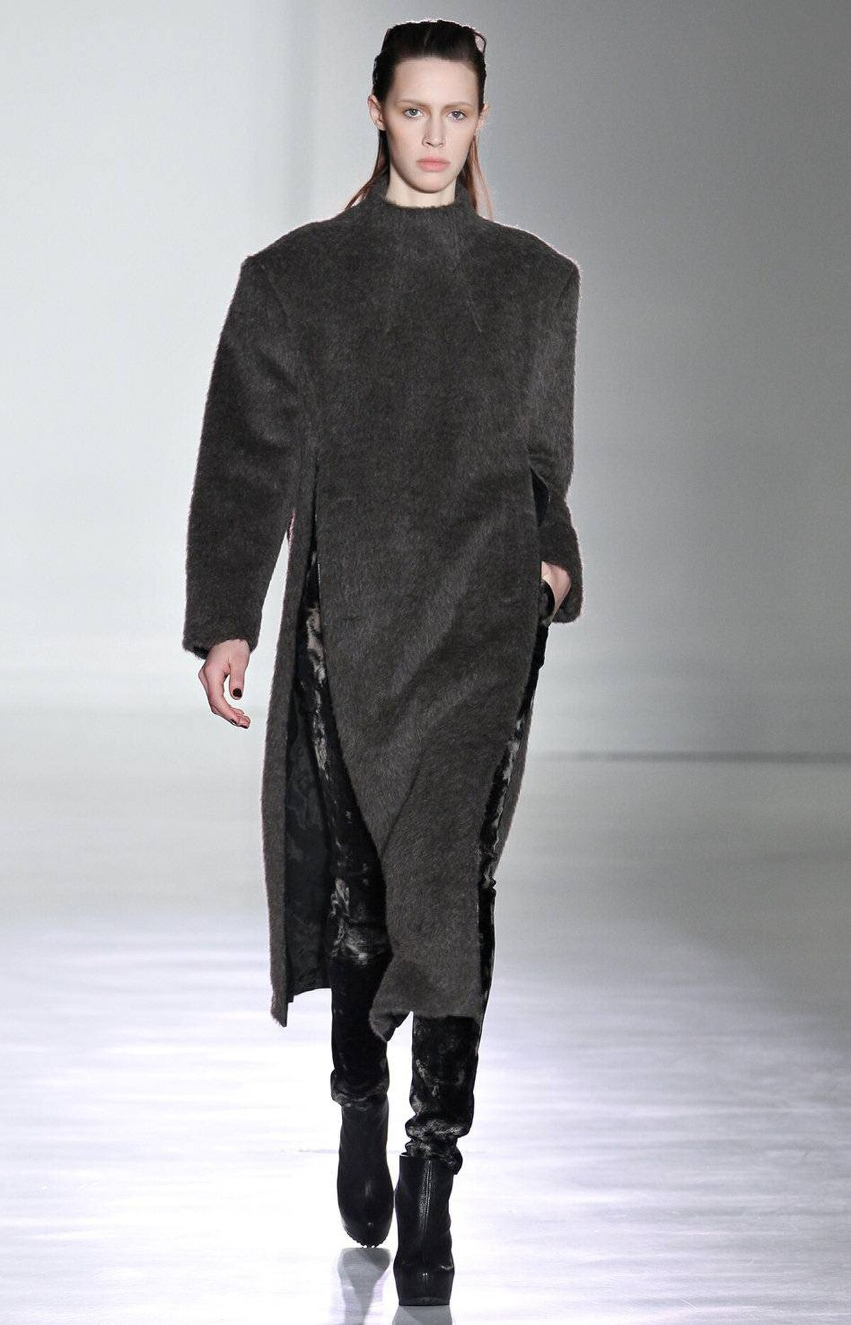Zippers, at the sides and up the back, brought movement to heavier fabrics such as this pullover coat in sheared mohair. Laing bleached velvet to achieve the pattern on this legging. But most notable are the shoulders: extra wide but not angular.