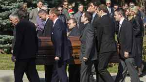 Pallbearers, including NHL hockey player Jason Spezza, exit Islington United Church with the casket containing the remains of ski-cross racer Nik Zoricic following Zoricic's funeral in Toronto, Monday.
