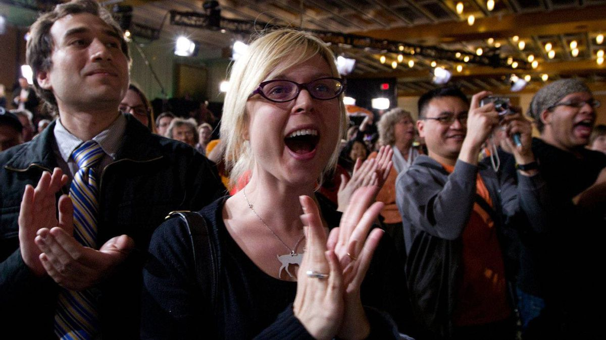 New Democratic Party supporters cheer as they watch results come in from the east coast at NDP leader Jack Layton's election event in Toronto, Ont., on Monday, May 2, 2011.