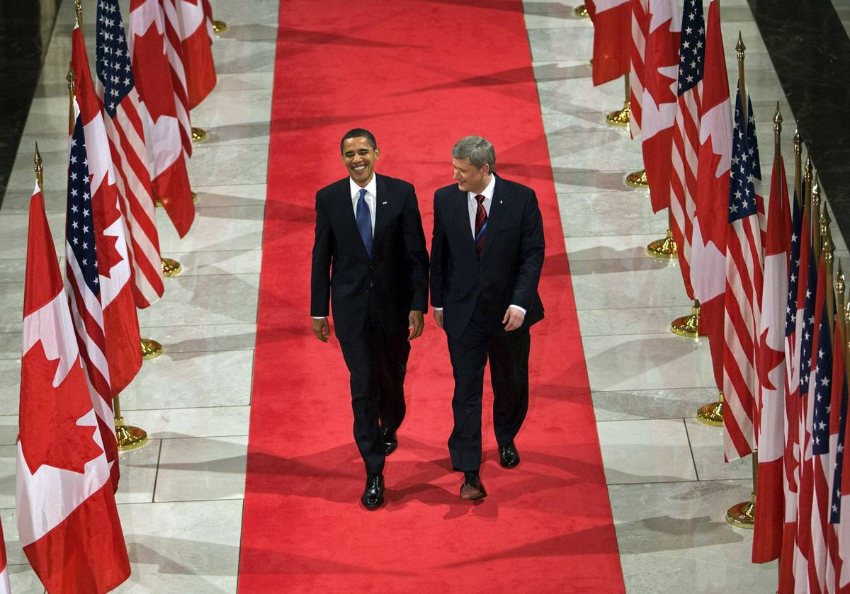 U.S. President Barack Obama and Prime Minister Stephen Harper arrive for a joint news conference during his one-day visit to Ottawa on Feb. 19, 2009.