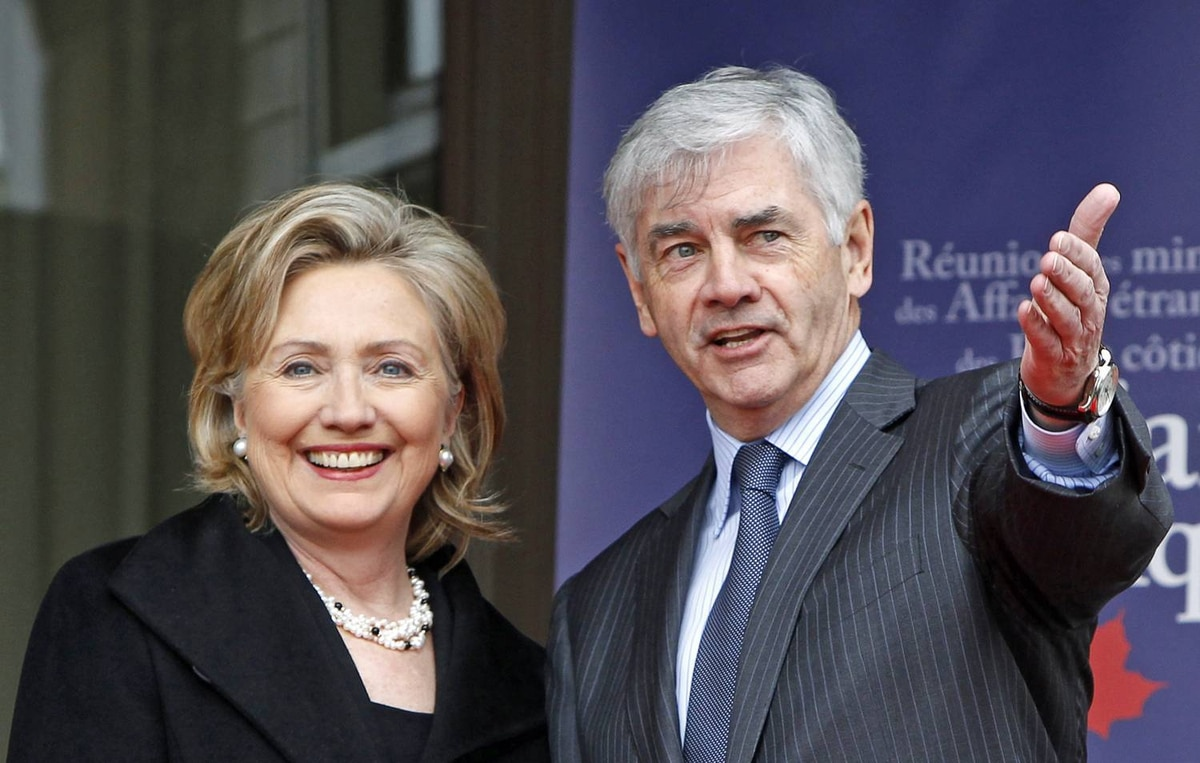 Foreign Affairs Minister Lawrence Cannon greets U.S. Secretary of State Hillary Clinton as she arrives at an Arctic leaders meeting meeting in Chelsea, Que., on March 29, 2010.