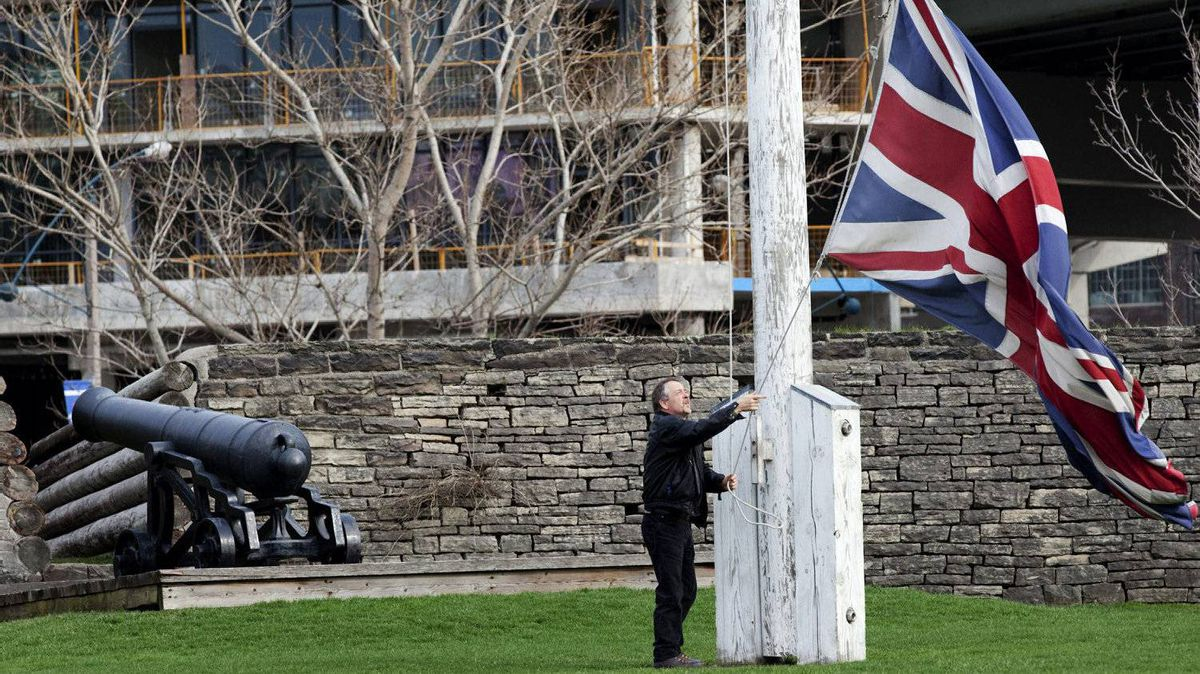 At the end of the day Rene Malagon pulls down the British Flag at Fort York in Toronto on March 23, 2012. The museum will be affected tomorrow if an impending indoor workers city strike is announced.