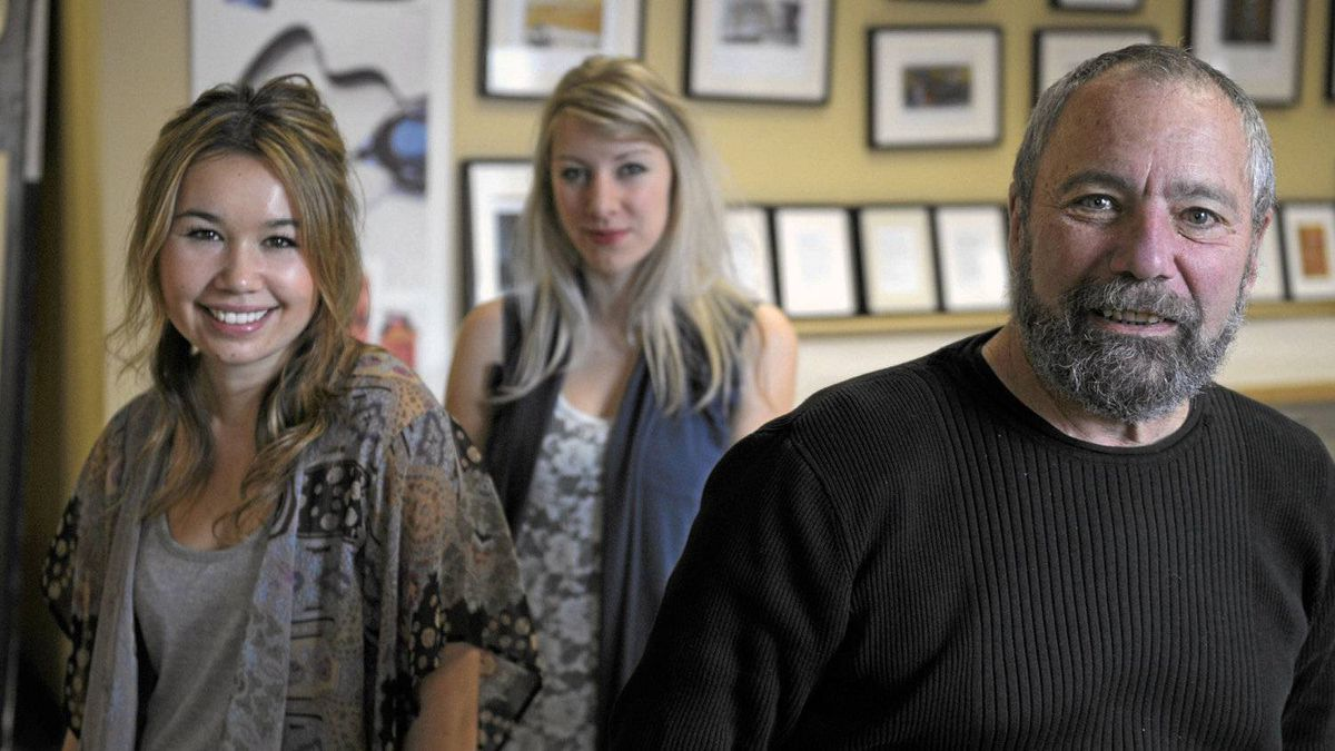 Michael Rosen, co-ordinator of Humber College's creative advertising program, with third year students Sarah Kirkpatrick,centre, and Rachel Kennedy, left.