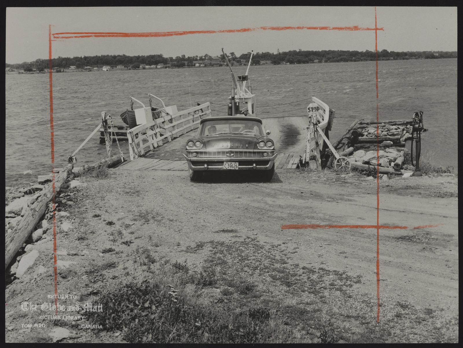 The notes transcribed from the back of this photograph are as follows: To be replaced by bridge from Tyendinaga Indian reserve at Deseronto to Prince Edward County, double ended car carrier has been crossing three-quarter-mile gap for over 80 years.