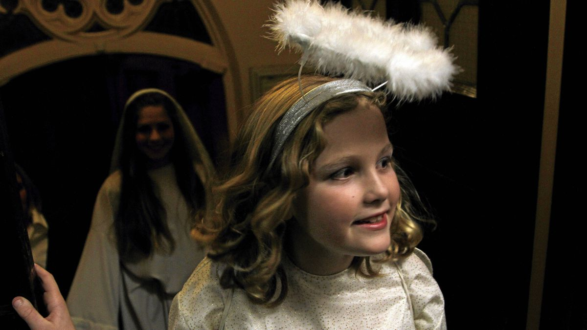 """Abby McDermott, 9, (front) was a Bethlehem girl in last year's performance, which meant she sang carols with a small group of other girls. This year, she has her own lines. """"I'm the angel. I'm the one who tells Mary she'll have baby Jesus,"""" Abby says. """"I'm kind of nervous."""""""