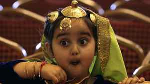A young girl reacts as she watches a turban tying competition in Surrey, B.C., on Monday April 5, 2010.