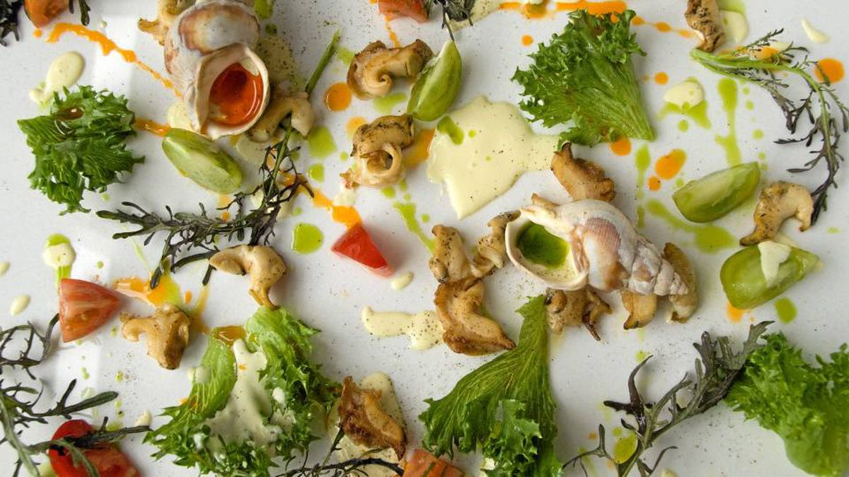 Fresh from the waters of the Gaspésie, whelks are a seasonal treat on the tasting menu, served simply with greens.
