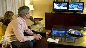 Liberal Leader Michael Ignatieff watches election results roll in with his wife Zsuzsanna Zsohar on May 2, 2011.
