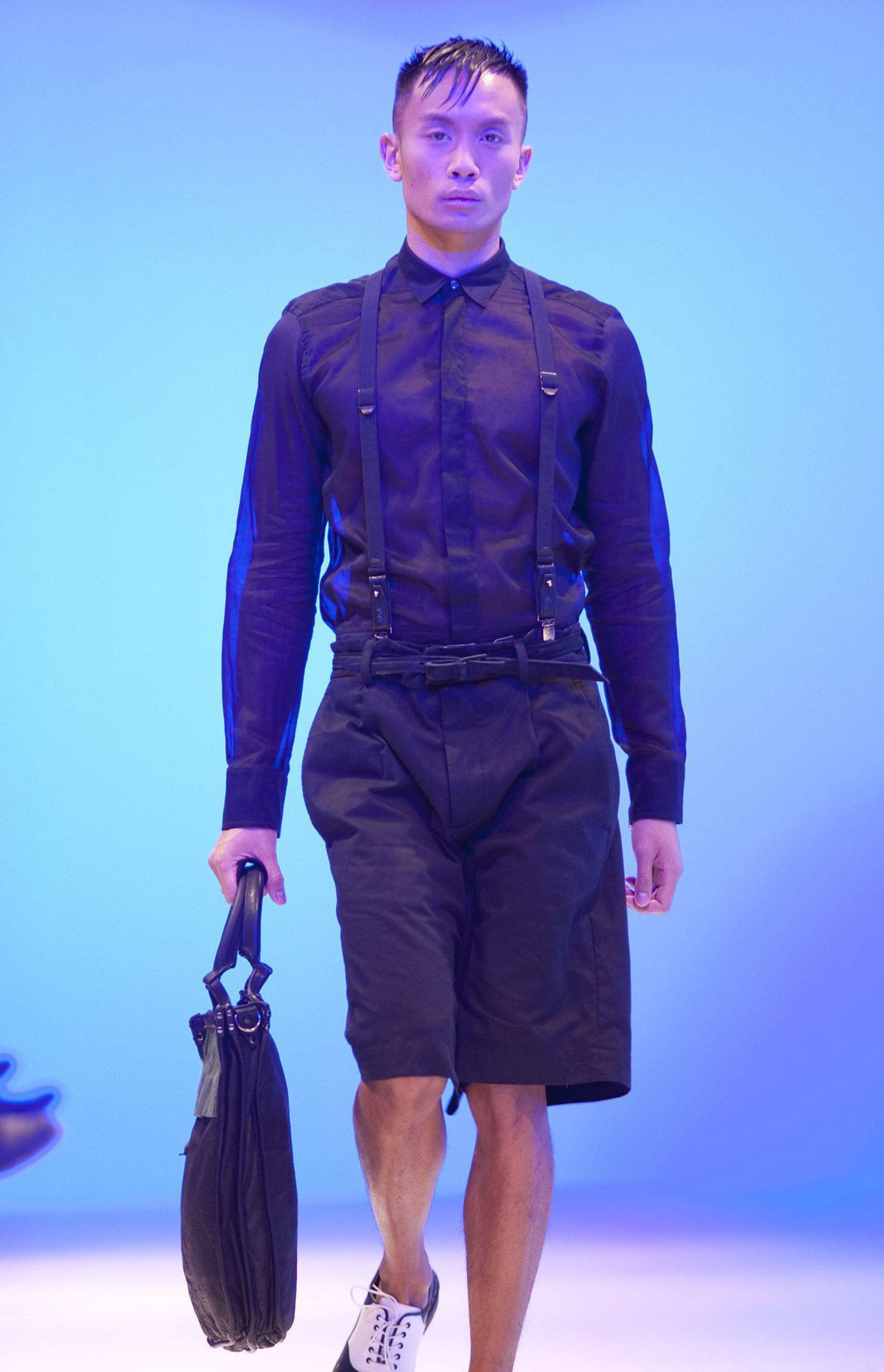 Fitted dress shirts with covered buttons paired with baggy shorts were cute enough, but most audience members were oohing and ahhing over the accessories, especially the leather handbags and satchels.