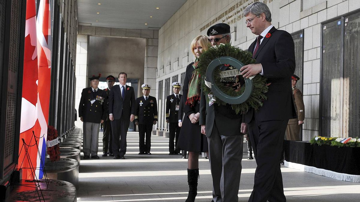 Mr. Harper carries places the wreath.