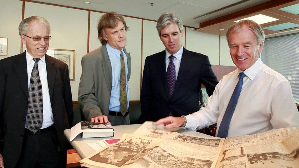 (From left to right) John Tory, a director of Woodbridge, the Thomson family investment company, David Thomson, Geoff Beattie, president of Woodbridge and Phillip Crawley, publisher of The Globe and Mail, look at a 1969 copy of The Globe and Mail newspaper, featuring the first moon landing. They met on Friday Sept. 10 at The Globe and Mail in Toronto.