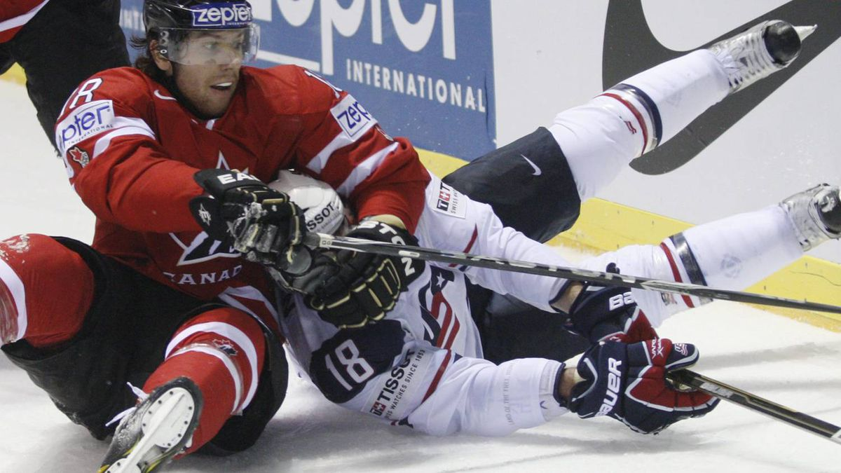 Canada's James Neal, left, collides with Mike Brown of the US, right, during their qualification round group F hockey World Championships match in Kosice, Slovakia, Friday, May 6, 2011. (AP Photo/Petr David Josek)
