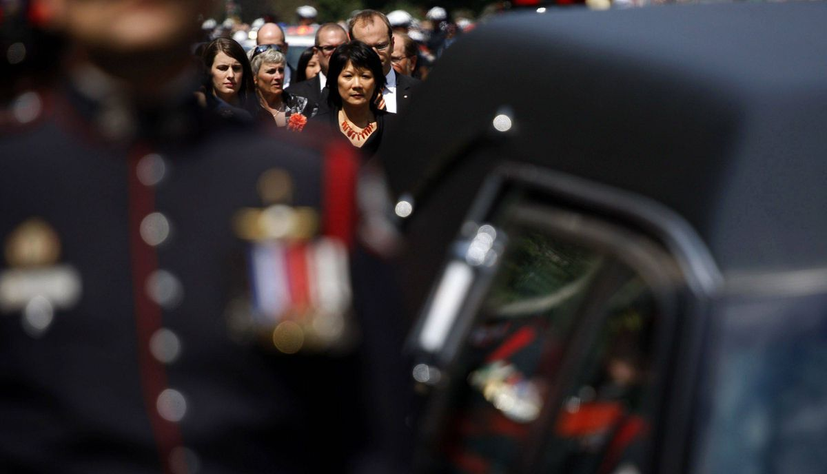 Olivia Chow follows the hearse carrying her husband, NDP Opposition Leader Jack Layton, during a procession on route to his state funeral.