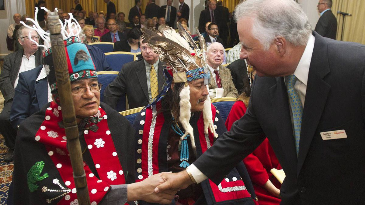 Enbridge Inc. chairman David Arledge shakes hands with John Ridsdale, Chief Na'Moks, of the Wet'suwet'en First Nation, left, and Chief Martin Louie of Nadleh Whut'en nation.