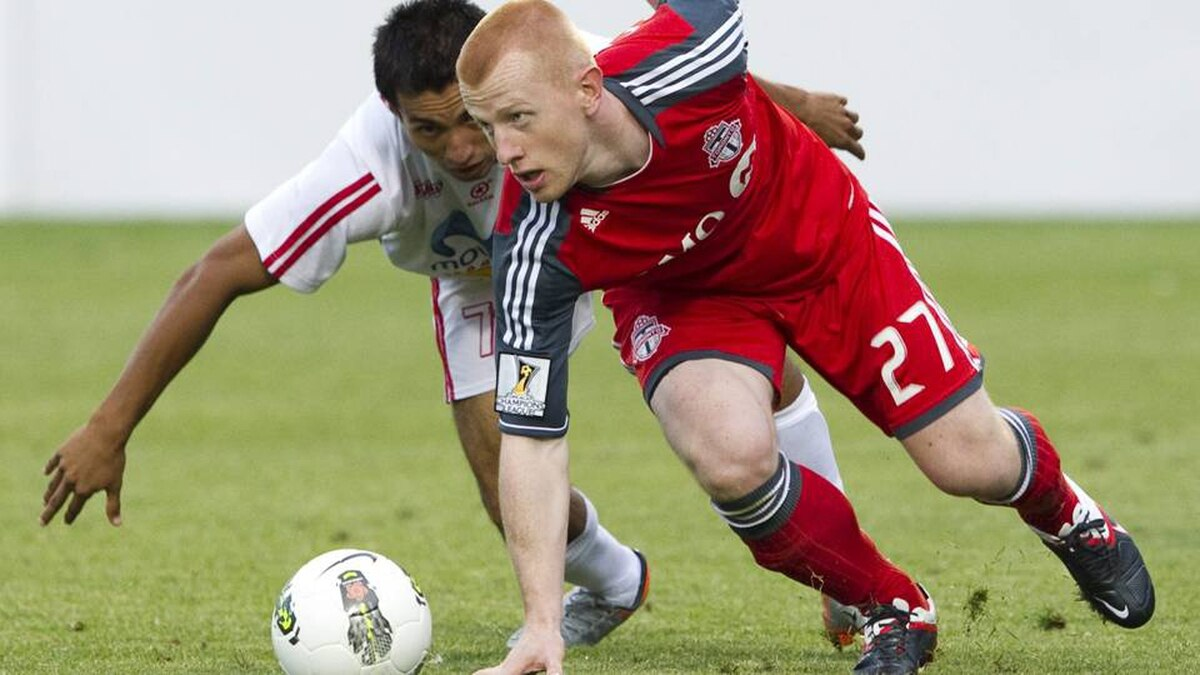 Toronto FC's Richard Eckersley, right, and Real Esteli FC's Manuel Rosas battle for the ball during the first half of a CONCACAF Champions League soccer match in Toronto