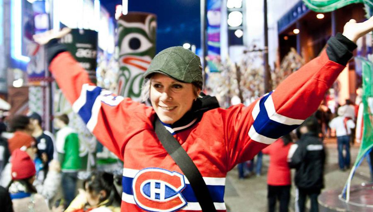"""Brittney Kwasney sent us this photo. She writes, """"I've been wearing this Patrick Roy jersey around since I was 10 years old, and what better a night than to wear it downtown Vancouver after Cananda won gold! Let's go Habs!"""""""