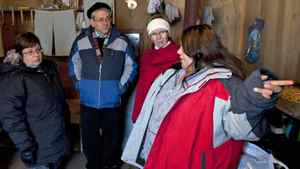 Band Chief Theresa Spence, MP Charlie Angus and Interim NDP Leader Nycole Turmel listen to an Attawapiskat resident describe conditions in her temporary shelter on the Norther Ontario reserve on Nov. 29, 2011.