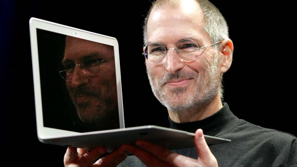 Steve Jobs holds up the new MacBook Air after giving the keynote address at the Apple MacWorld Conference in San Francisco on Jan. 15, 2008.