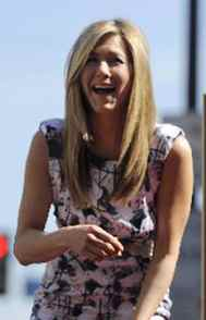 Jennifer Aniston, is that you? We're having trouble with the audio. Picture's lousy too.