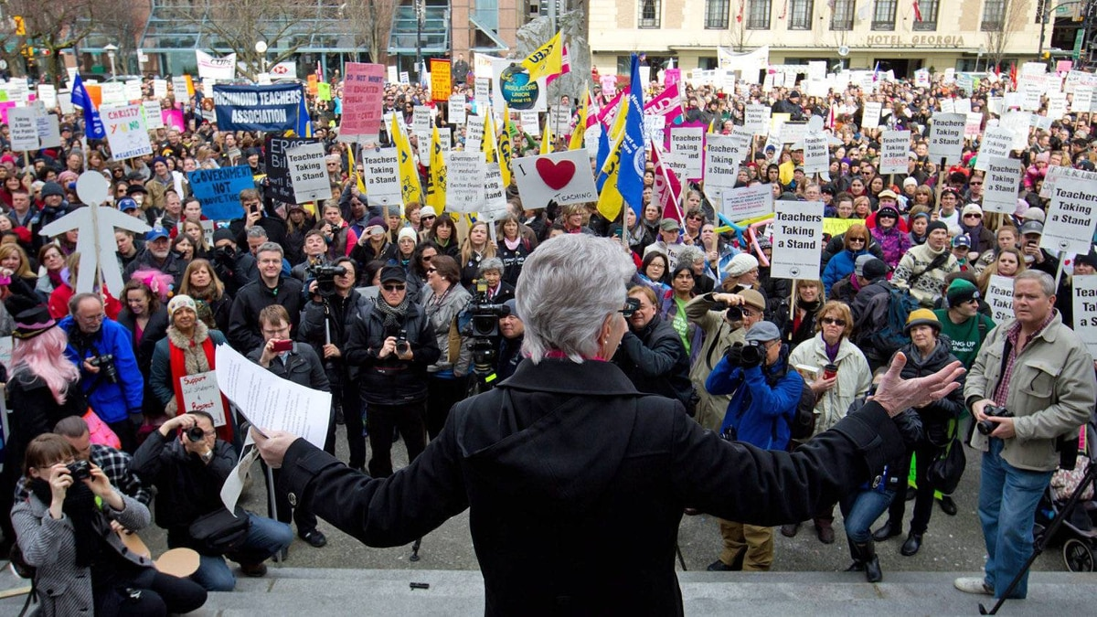 British Columbia Teacher's Federation president Susan Lambert addresses striking teachers and other supporters during a rally on the final day of a three-day province wide walkout in Vancouver, B.C., on March 7, 2012.