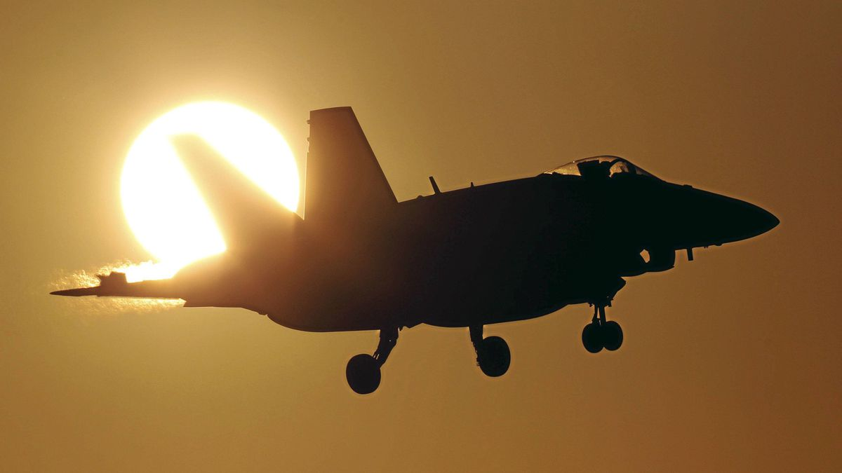 A Canadian CF-18A fighter prepares to land at the Birgi NATO Airbase in Trapani on the southern Italian island of Sicily March 21, 2011. Arab nations do not want the military intervention under way in Libya to be placed under NATO control, French Foreign Minister Alain Juppe said on Monday.