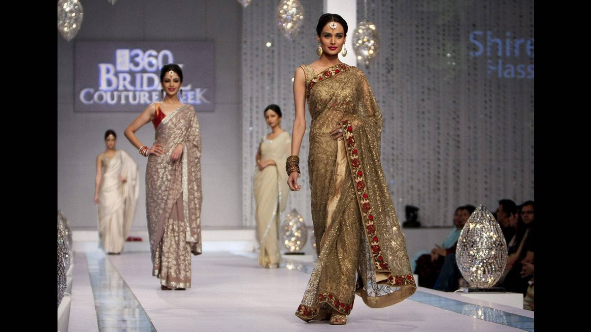 Pakistani models present the creation of a local designer, Mona Imran, during a fashion show in Karachi, Pakistan on April 23, 2011.