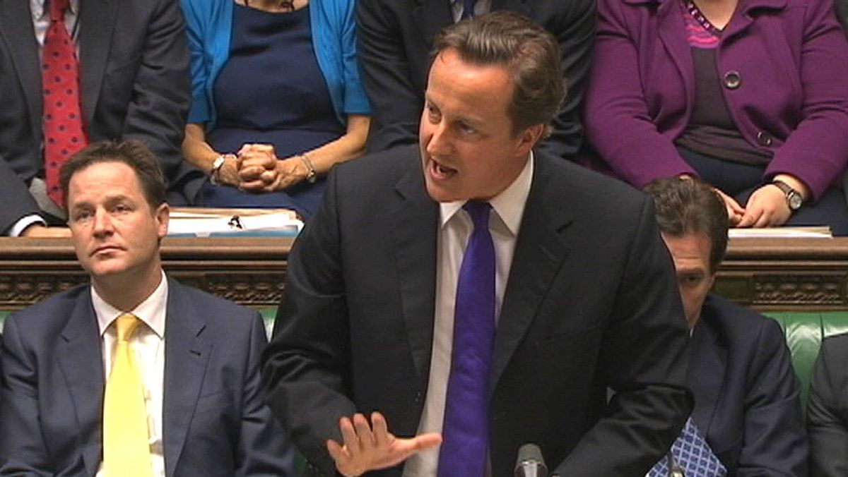 Britain's Prime Minister David Cameron, flanked by Deputy Prime Minister Nick Clegg, left, speaks about phone hacking to parliament in a still image taken from video in London July 20, 2011. Cameron on Wednesday defended the way his staff dealt with the police over allegations of phone-hacking and bribery at Rupert Murdoch's British newspapers .
