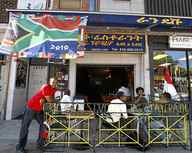 """Restaurant owner Yohannes """"Johnny"""" Zerea stands outside the Rendez-vous on the Danforth, which has a thriving Ethiopian community near the intersection of Greenwood Avenue."""