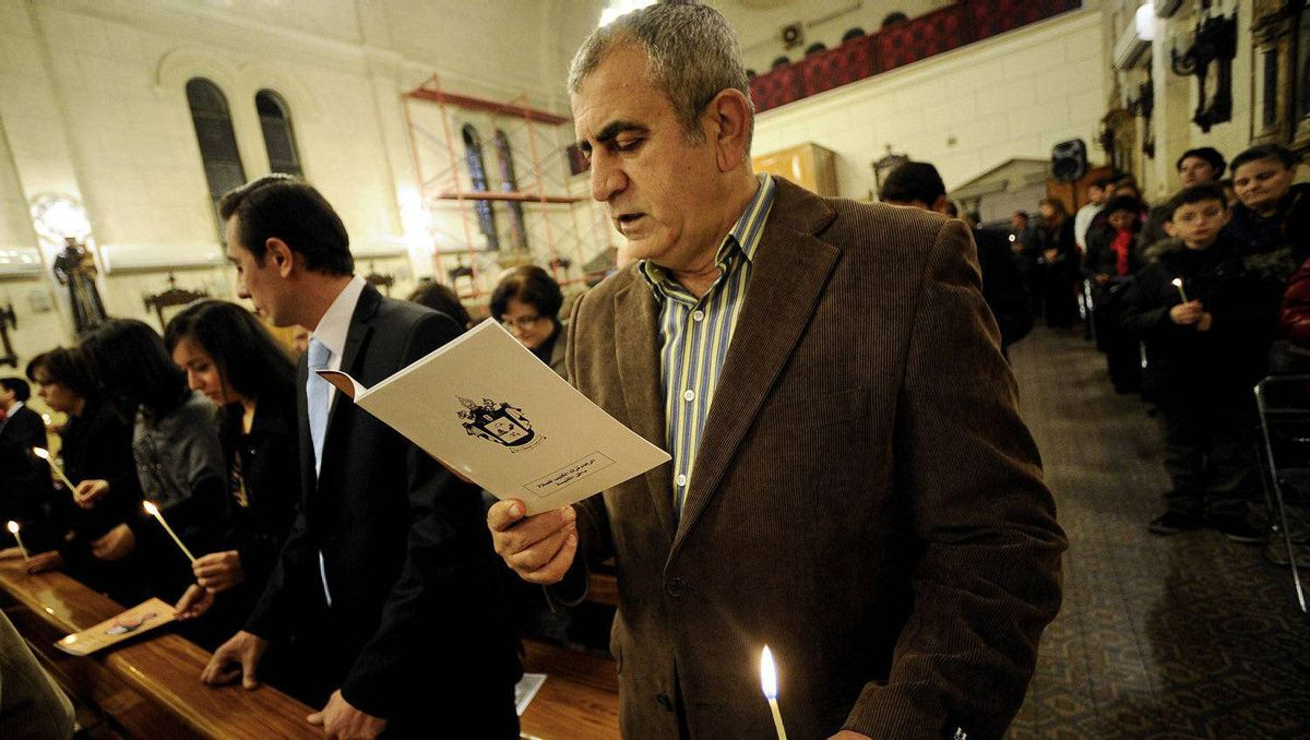 People attend Christmas eve mass at St. Therese Christian Armenian