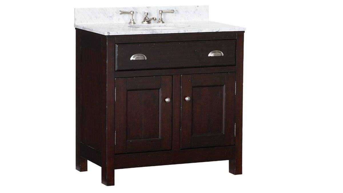 Pottery Barn's single-sink Covelo console with thick Carrara-marble top is meticulously crafted of solid pine and pine veneer and finished by hand in a rustic amber stain. $1,699 plus shipping through www.potterybarn.com.